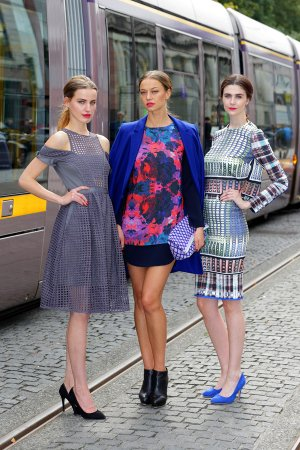 Models posing by Luas Tram, Dublin Fashion Festival PR.