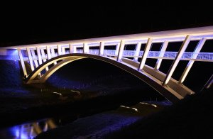 Bridge at Night, lit up, professional editorial photograph.