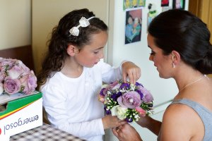 Flowergirl checking bridal flowers.