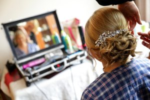 Bridal hair and makeup on morning of her wedding day.
