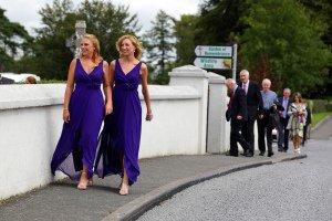 Bridesmaids walking to church.