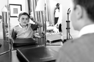Pageboy checking his hair getting ready for wedding at Tulfarris.