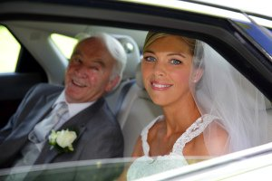 Bride and her Father arriving in car at the church.