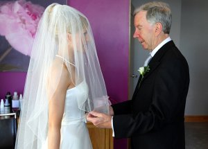 Bride and her Father lifting the veil.