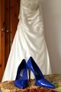 Wedding photography of bridal shoes and dress.