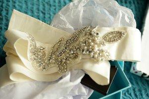 Wedding dress sash detail photograph.