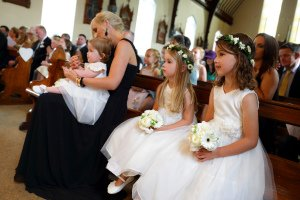 Flowergirls during wedding ceremony.
