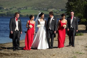 Bridal Party walking on lakeshore.