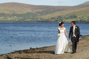 Bride & Groom walking by Blessington Lakes, Stunning wedding photo.