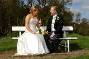 Bride & Groom Chatting on Bench. Contemporary Wedding Photography.