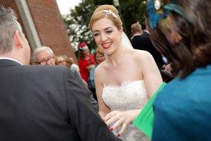 Bride greeting guests.