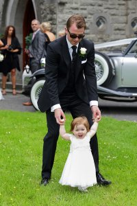Groom and Flowergirl, fun wedding photo.