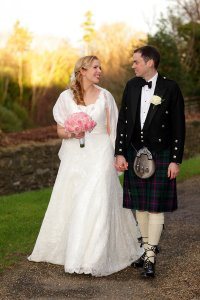 Bride and Groom walking at Drudis Glen, wedding photograph.