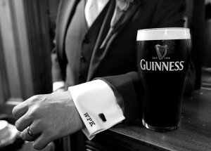 Close up of Groom & Guinness at Wedding Reception.