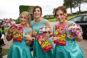 Bridesmaids haivng fun at wedding reception.