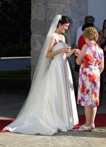 Bride talking to wedding guest, social photo.
