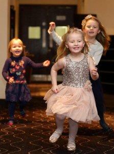 Kids having fun at wedding reception.