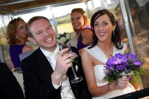 Bride and Groom having fun at wedding reception.