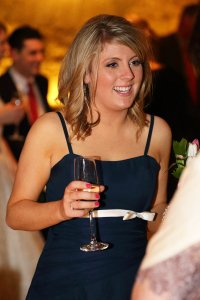 Bridesmaid enjoying wedding reception.