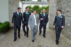 Grooms and groomsmen walking at Tulfarris.