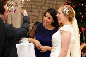 Guests chatting at wedding reception.