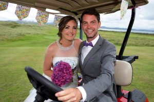 Bride and Groom having fun in golf cart at their wedding.
