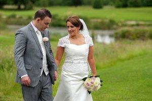 Bride & groom walking in grounds at Tulfarris.