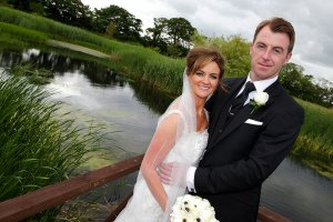 Bride and Groom portrait by lake.