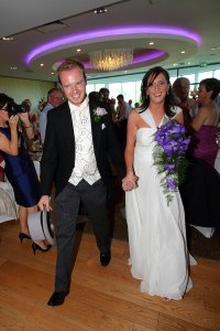 Bride and Groom arriving at their wedding meal.