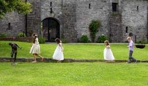 Kids playing at wedding reception.