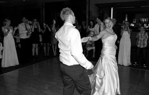 First dance of bride and groom at wedding reception.