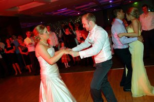 First dance at wedding reception, bride and groom on the dancefloor.