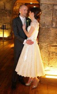 Wedding couple embracing, formal photo.