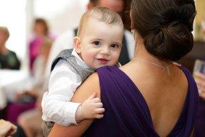 Toddler enjoying wedding reception.