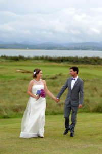 Bride and Groom walking towards camera.