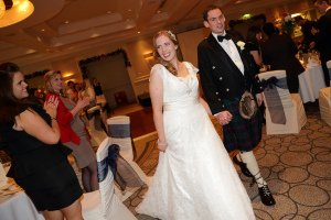 Bride and Groom in kilt arriving at their wedding reception.