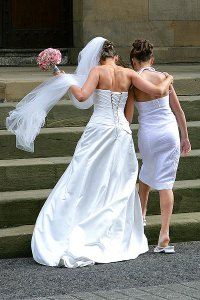 Bride & Flower Girl Walking towards church.