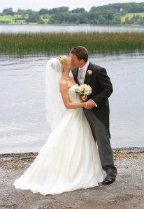 Wineport Wedding Photography of couple by lake.