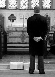 Groom waiting at altar